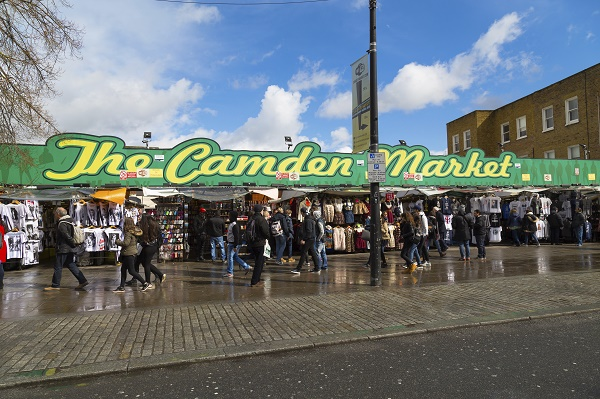 LONDON, UK - 26TH MARCH 2015: The outside of Camden Market in London showing markets stalls and people