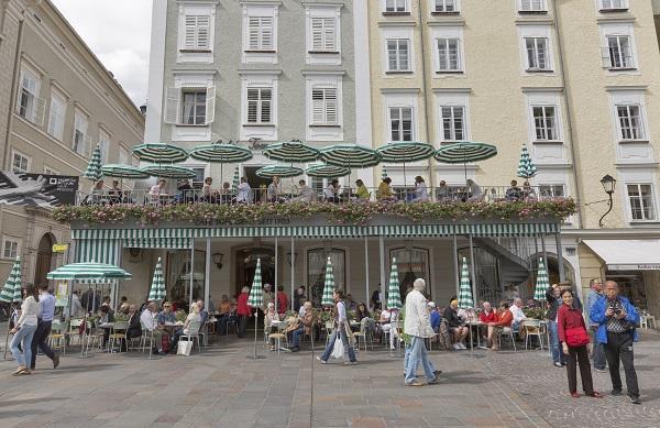 SALZBURG, AUSTRIA - SEPTEMBER 09, 2015: Unrecognized people visit famous Tomasseli Cafe , the oldest cafe in city. Salzburg is the 4th biggest city in Austria.