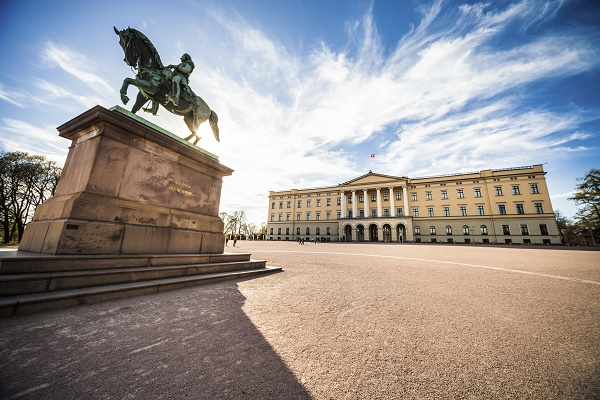 Oslo, Norway - April 19, 2015: View of the Slottet, the Royal Palace in Oslo in sunny daylight. The image is shot inside the square in front of it during a beautiful day with an huge blue sky.